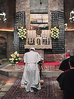 Pope Francis visits the tomb of St Francis as part of his pastoral visit in Assisi on October 4, 2013.