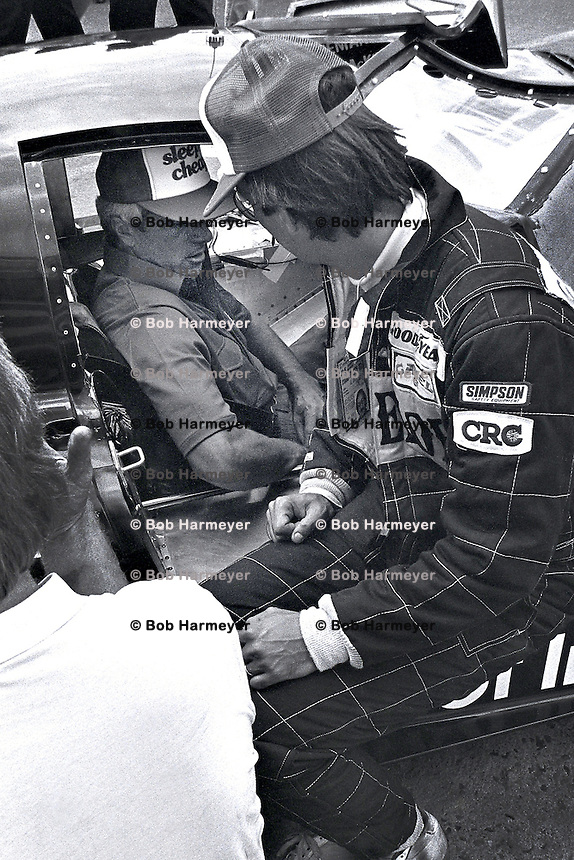 LE MANS, FRANCE - JUNE 20: Bobby Rahal (right) speaks with co-driver Jim Trueman, sitting in the March 82G 1/Chevrolet, before practice for the 24 Hours of Le Mans on June 20, 1982, at Circuit de la Sarthe near Le Mans, France.