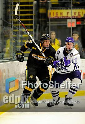 29 December 2007: University of Vermont Catamounts' defenceman Kevan Miller, a Freshman from Los Angeles, CA, in action against the Holy Cross Crusaders at Gutterson Fieldhouse in Burlington, Vermont. The Catamounts rallied in the final seconds of play to tie the game 1-1. After overtime, although the official result remained a tie game, the Cats moved up to the championship round by winning a sudden death shootout in the second game of the Sheraton/TD Banknorth Catamount Cup Tournament...Mandatory Photo Credit: Ed Wolfstein Photo