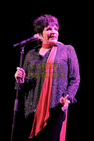 Liza Minnelli.performing in concert, Royal Festival Hall, London, England, UK, .1st March 2013..live music on stage in concert half length red scarf black jacket microphone .CAP/MAR.© Martin Harris/Capital Pictures.