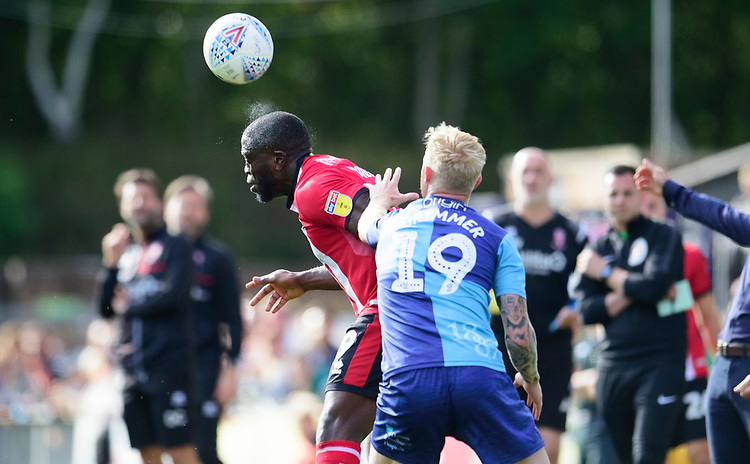 Lincoln City's John Akinde battles with Wycombe Wanderers' Jack Grimmer<br /> <br /> Photographer Andrew Vaughan/CameraSport<br /> <br /> The EFL Sky Bet League One - Wycombe Wanderers v Lincoln City - Saturday 7th September 2019 - Adams Park - Wycombe<br /> <br /> World Copyright © 2019 CameraSport. All rights reserved. 43 Linden Ave. Countesthorpe. Leicester. England. LE8 5PG - Tel: +44 (0) 116 277 4147 - admin@camerasport.com - www.camerasport.com
