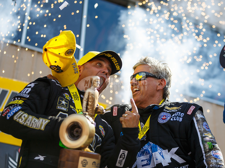 Jul 24, 2016; Morrison, CO, USA; NHRA top fuel driver Tony Schumacher (left) reacts as he celebrates with funny car driver John Force after winning the Mile High Nationals at Bandimere Speedway. Mandatory Credit: Mark J. Rebilas-USA TODAY Sports