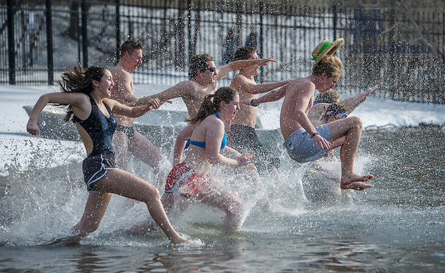 Feb. 7, 2015; Students in Notre Dame's Dillon and Badin Halls held the annual 2015 Polar Bear Plunge in St. Joseph's Lake. The activity allowed students to raise funds for the HOPE Initiative, a charity in Nepal that promotes education and operates an orphanage. (Photo by Barbara Johnston/University of Notre Dame)