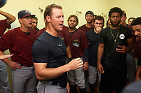 Mahoning Valley Scrappers manager Luke Carlin addresses the team in the locker room after winning the division title during the second game of a doubleheader against the Batavia Muckdogs on September 4, 2017 at Dwyer Stadium in Batavia, New York.  Mahoning Valley defeated Batavia 6-2 to clinch the Pinckney Division Title.  (Mike Janes/Four Seam Images)