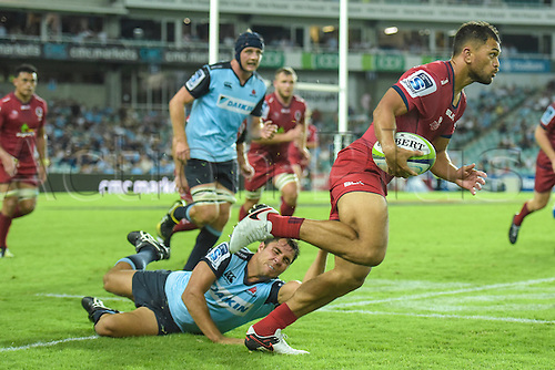 27.02.2016.  Sydney, Australia. Super Rugby. NSW Waratahs versus Queensland Reds. Reds fullback Karmichael Hunt is tackled by Waratahs scrum half Nick Phipps. The Waratahs won 30-10.