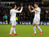 (L-R) Leon Britton and team mate Jack Cork of Swansea celebrate their win during the Barclays Premier League match between Swansea City and Watford at the Liberty Stadium, Swansea on January 18 2016
