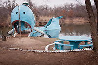 The Blue Whale of Catoosa is a waterfront structure, located just east of the town of Catoosa, Oklahoma, and it has become one of the most recognizable attractions on old Route 66.<br /> Hugh Davis built the Blue Whale in the early 1970s as a surprise anniversary gift to his wife Zelta, who collected whale figurines.[1] The Blue Whale and its pond became a favorite swimming hole for both locals and travelers along Route 66 alike.<br /> <br /> Originally, the pond surrounding the massive Blue Whale was spring fed and intended only for family use. However, as many locals began to come to enjoy its cool waters, Davis brought in tons of sand, built picnic tables, hired life guards, and opened his masterpiece to the public.