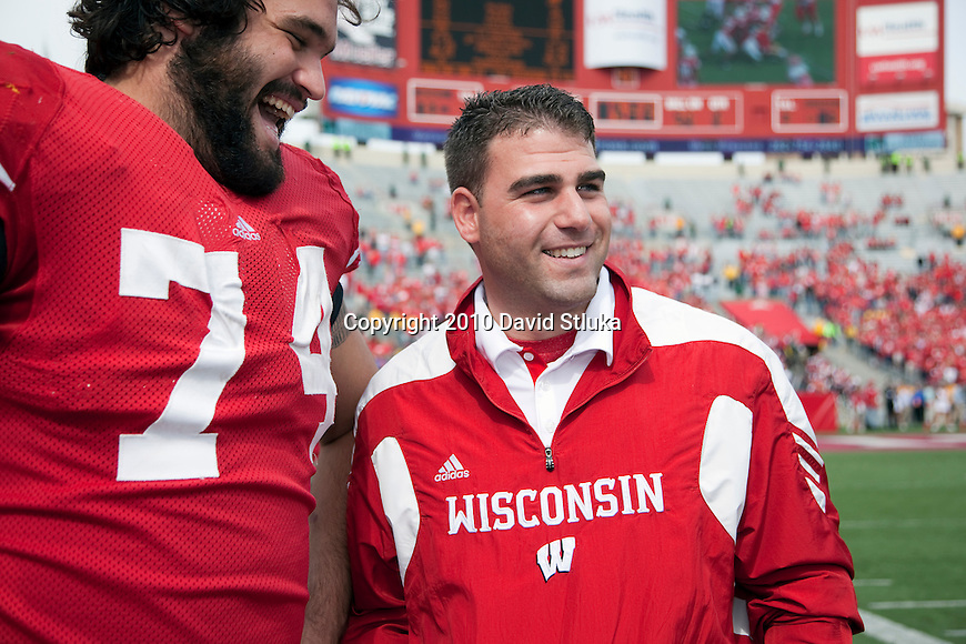Wisconsin Badgers Director of Football Operations Mark Taurasani talks to lineman John Moffitt (74) during an NCAA college football game against the Austin Peay Governors on September 25, 2010 at Camp Randall Stadium in Madison, Wisconsin. The Badgers beat the Governors 70-3. (Photo by David Stluka)