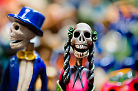 Calaca figurines are sold on the market during the Day of the Dead festival in Mexico City, Mexico, 28 October 2016. Skulls, skeletons and the other death symbols are used to adorn graves, altars and offerings during the Day of the Dead (Día de Muertos). A syncretic religious holiday, combining the death veneration rituals of the ancient Aztec culture with the Catholic practice, is celebrated throughout all Mexico. Based on the belief that the souls of the departed may come back to this world on that day, people gather at the gravesites in cemeteries, praying, drinking and playing music, to joyfully remember friends or family members who have died and to support their souls on the spiritual journey.