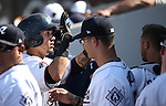 The Reno Aces greet Ildemaro Vargas in the dugout after he scored against the Tacoma Rainiers at Greater Nevada Field in Reno, Nev., on Sunday, Aug. 28, 2016. <br />