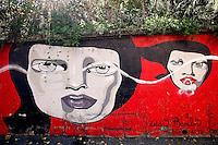 Titolo: Senza Titolo,  Artista Zelda Bomba<br /> Title none, Artist Zelda Bomba<br /> Neo pop, controcultura, gusto vintage e allucinazioni per questa artista francese. Volti femminili surreali ed inquieti, labbra laccate, tinte piatte e decise<br /> Roma 01-02-2015 Street Art a Roma. In vari quartieri di Roma e' fiorita la Street Art, con splendidi murales che hanno lo scopo di raccontare delle storie della citta', di commemorare dei momenti importanti, o semplicemente di interpretarla.<br /> Street Art in Rome. Very important writers  painted Murales in various districts of Rome to tell stories about the city, to commemorate important moments, to embellish the quarter or simply to portray it.  <br /> Photo Samantha Zucchi Insidefoto
