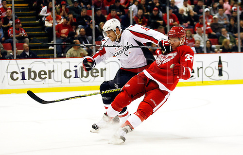 10th October 2009: Washington Capitals right wing Eric Fehr (16) pushes over Detroit Red Wings right wing Kris Draper (33) in the third period of the Washington Capitals at Detroit Red Wings NHL hockey game, at Joe Louis Arena, in Detroit, MI. The Red Wings won 3-2. Photo by Tony Ding/Actionplus. UK Licenses Only...