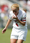NC State's Michelle Massey, her hands covered in blood, tries to stop her nose from bleeding on Sunday October 2nd, 2005 at SAS Stadium in Cary, North Carolina. The Duke University Blue Devils defeated the North Carolina State University Wolfpack 1-0 during an Atlantic Coast Conference women's soccer game.