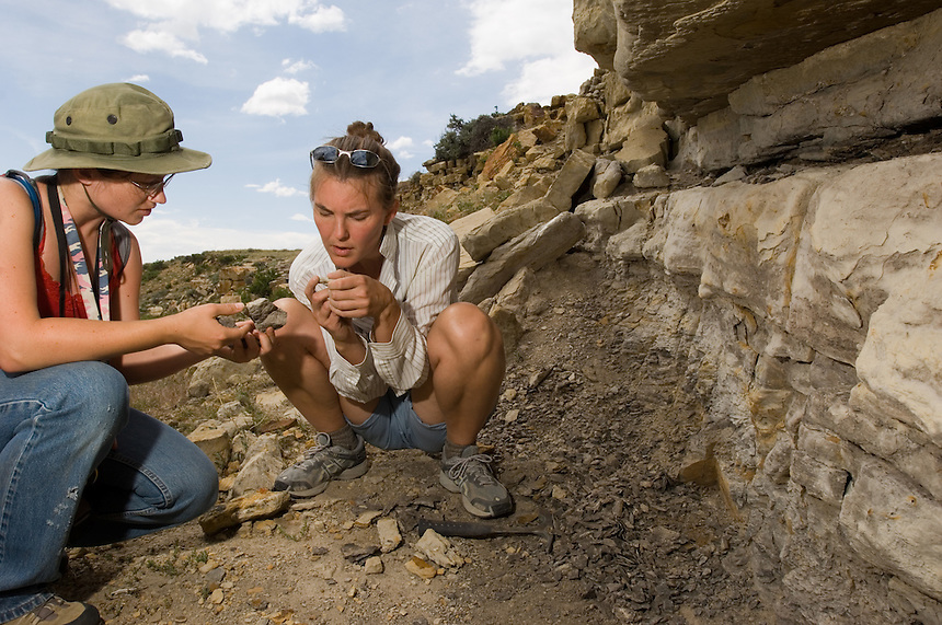 Paleobotanist Mandi Lyon, right, of Pennsylvania University, with Casper College geology student Braby Talbot, examines a shale bed for remnant plant fossils and traces on a part of the Allen Cook ranch recently donated to the University of Pittsburgh for research. The ranch property features cretaceous rock formations preservibg dinosaur fossils, high-plains grassland ecology and interesting tectonic geology for study by the students and faculty of Pittsburg, the University of Wyoming and the Carnegie Museum. (photo/Kevin Moloney)