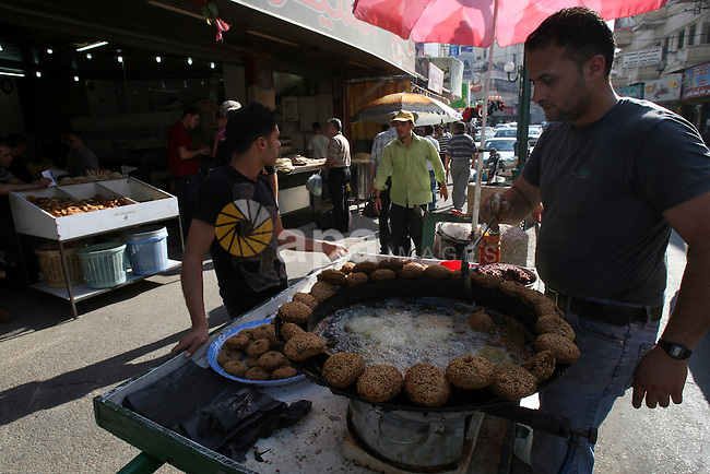 "A Palestinian vendor prepares traditional foods ""falafel"", in a market in the West Bank city of Nablus, on Aug. 10, 2011. Muslims around the world are observing the holy fasting month of Ramadan where they refrain from eating, drinking, smoking from dawn to dusk.  Photo by Wagdi Eshtayah"