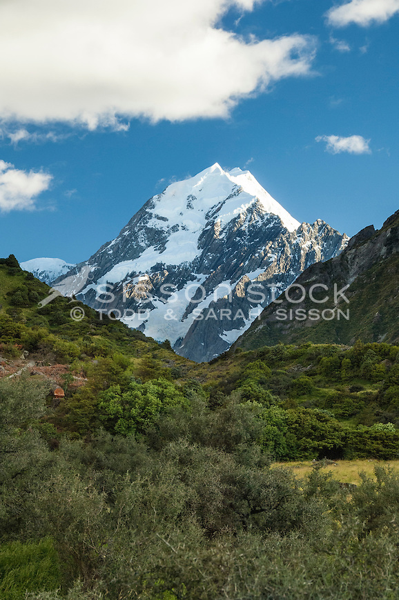 Photo of Mount Cook / Aoraki Summit on a blue sky day from the start of the Hooker Valley Track. (Vertical / Portrait).