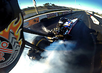 Jan. 16, 2014; Jupiter, FL, USA: Onboard camera view as NHRA top fuel dragster driver Antron Brown does a burnout  during testing at the PRO Winter Warmup at Palm Beach International Raceway. Mandatory Credit: Mark J. Rebilas-USA TODAY Sports