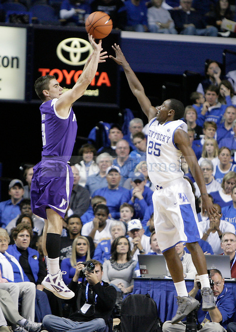 Marquis Teague attempts to block a three against Portland at Rupp Arena on Saturday, Nov. 26, 2011. Photo by Scott Hannigan | Staff