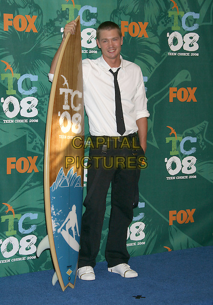 CHAD MICHAEL MURRAY .2008 Teen Choice Awards held at the Gibson Amphitheater,  Universal City, California, USA, .03 August 2008..full length black tie white shirt surf board trainers jeans braces .CAP/ADM/MJ.©Michael Jade/Admedia/Capital Pictures