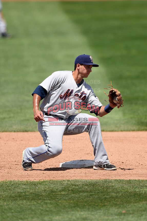 Binghamton Mets shortstop T.J. Rivera (5) waits for the runner on a stolen base attempt during a game against the Erie Seawolves on July 13, 2014 at Jerry Uht Park in Erie, Pennsylvania.  Binghamton defeated Erie 5-4.  (Mike Janes/Four Seam Images)