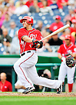 24 September 2011: Washington Nationals first baseman Chris Marrero gets an RBI single against the Atlanta Braves at Nationals Park in Washington, DC. The Nationals defeated the Braves 4-1 to even up their 3-game series. Mandatory Credit: Ed Wolfstein Photo