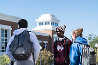 Students chat on plaza between Colvard Student Union and George Hall: Camron Bennett, Devron Cheatonm and Haley Sbravati.<br />