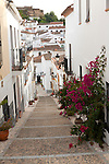 Whitewashed houses cobbled street, Almonaster La Real, Sierra de Aracena, Huelva province, Spain