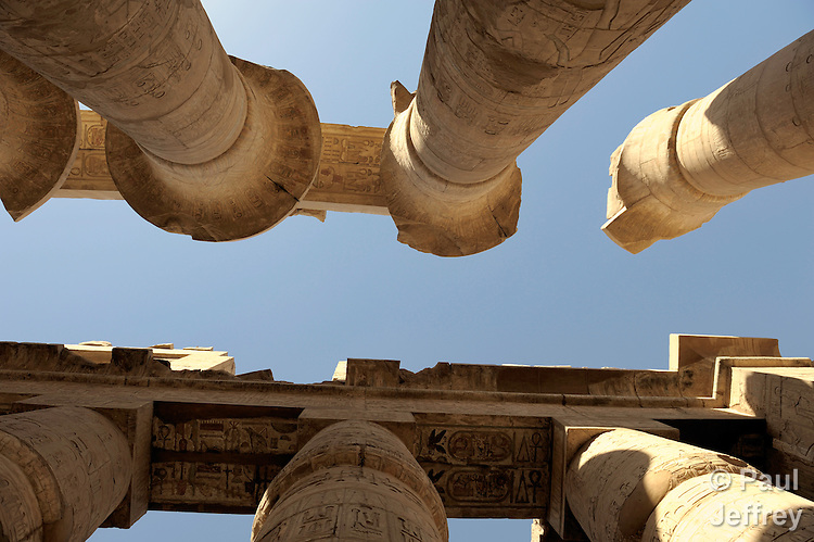 A portion of the Temple of Karnak complex, in Luxor, Egypt, which is famous for its 134 massive columns arranged in 16 rows in the Hypostyle Hall. 122 of these columns are 10 meters tall the other 12 are 21 meters tall with a diameter of over three meters. The architraves on top of these columns weigh an estimated 70 tons.