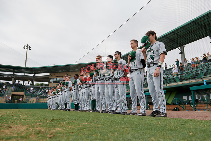 Dartmouth Big Green players, including Trevor Johnson (36), Tyler Fagler (31), Jordan Bustabad (37), Jonah Jenkins (32), Jack Schmidt (34), Justin Murray (6), Max Hunter (19), Michael Parsons (22), Steffen Torgersen (29), Blake Crossing (13), Alec Vaules (39), and Eric Stolt (17) stand for the national anthem before a game against the USF Bulls on March 17, 2019 at USF Baseball Stadium in Tampa, Florida.  USF defeated Dartmouth 4-1.  (Mike Janes/Four Seam Images)