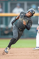 Vanderbilt Commodores /2b/ Harrison Ray (2) races around second base against the Michigan Wolverines during Game 2 of the NCAA College World Series Finals on June 25, 2019 at TD Ameritrade Park in Omaha, Nebraska. Vanderbilt defeated Michigan 4-1. (Andrew Woolley/Four Seam Images)