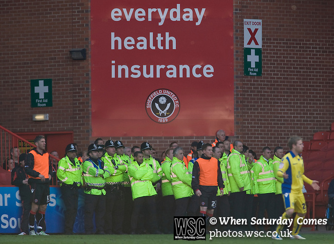 Sheffield United 2 Leeds United 0, 19/03/2011. Bramall Lane, Championship. Police and stewards watching the action from the sidelines during the first half of the Npower Championship fixture between Sheffield United and Leeds United at Bramall Lane. The home team won the game by two goals to nil watched by a crowd of 23,728. Bramall Lane is the world's oldest professional football ground and at one time hosted both football and cricket. Photo by Colin McPherson.