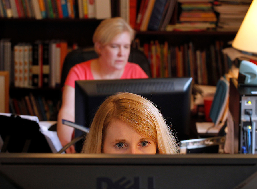 Senior editor Sara Hunt works in front of managing editor Deborah Samley, sitting behind, on edits for the assessment guides for fourth and fifth grade development level learning that will be used in New York Wednesday August 28, 2013 at the Core Knowledge Foundation in Charlottesville, VA.  Photo/Andrew Shurtleff