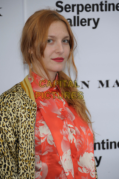 Josephine de La Baume.Serpentine Galley Summer Party, Kensington Palace Gardens, London, England..26th June 2012.half length red print top yellow jacket floral print red lipstick .CAP/PL .©Phil Loftus/Capital Pictures.