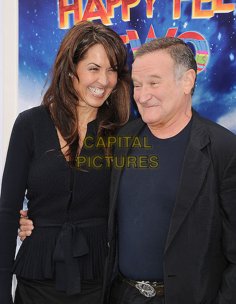 Susan Schneider & Robin Williams.The World Premiere of 'Happy Feet Two' held at The Grauman's Chinese Theatre in Hollywood, California, USA..November 13th, 2011.half length blue suit married husband wife black.CAP/ROT/TM.©Tony Michaels/Roth Stock/Capital Pictures