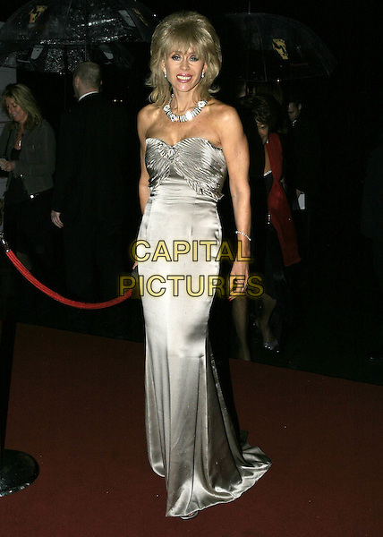 SALLY FARMALOW.Leaving the After Party for the Pioneer British Academy Television Awards (TV BAFTA's), Grosvenor House Hotel, .London, April 17th 2005..full length grey satin dress strapless Farmiloe.Ref: AH.www.capitalpictures.com.sales@capitalpictures.com.©Adam Houghton/Capital Pictures.