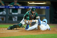 Miami Hurricanes catcher Joe Gomez (40) applies the tag to Zack Gahagan (10) of the North Carolina Tar Heels during the second semifinal of the 2017 ACC Baseball Championship at Louisville Slugger Field on May 27, 2017 in Louisville, Kentucky. The Tar Heels defeated the Hurricanes 12-4. (Brian Westerholt/Four Seam Images)