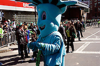 A man dressed as the Statue of Liberty marches in the St. Patrick's Day Parade in South Boston, Massachusetts.