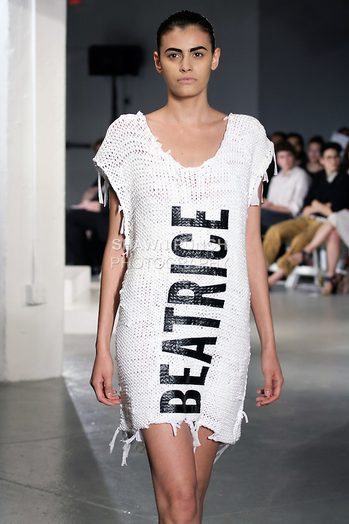 Model walks runway in an outfit by Beatrice Weiland, for the 2012 Pratt Institute fashion show, at Center548 NYC, on April 26, 2012.
