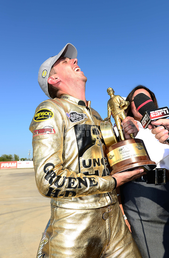 Sept. 23, 2012; Ennis, TX, USA: NHRA pro stock motorcycle rider Michael Ray celebrates after winning the Fall Nationals at the Texas Motorplex. Mandatory Credit: Mark J. Rebilas-