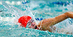 Willow Creek's Dinwoodey Greer competes in the 100 yard free race during the 53rd annual Country Club Swimming Championships on Monday, Aug. 6, 2012, in Kearns, Utah. (© 2012 Douglas C. Pizac)