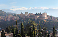 The Alhambra Palace, Granada, Andalusia, Southern Spain, with the Comares Tower (left), built in the 14th century under Muhammad V, the tallest tower in the Alhambra and housing the Hall of the Ambassadors, Nasrid Palaces, alcazaba and the Palace of Charles V in the background, built by Pedro Machuca in the 16th century. The Alhambra was begun in the 11th century as a castle, and in the 13th and 14th centuries served as the royal palace of the Nasrid sultans. The huge complex contains the Alcazaba, Nasrid palaces, gardens and Generalife. Behind are the snow-capped peaks of the Sierra Nevada. Granada was listed as a UNESCO World Heritage Site in 1984. Picture by Manuel Cohen