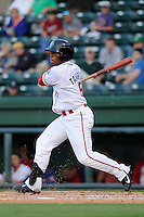 Outfielder Aneury Tavarez (5) of the Greenville Drive bats in a game against the Delmarva Shorebirds on Monday, April 29, 2013, at Fluor Field at the West End in Greenville, South Carolina. Greenville won, 3-1 in game two of a doubleheader. (Tom Priddy/Four Seam Images)