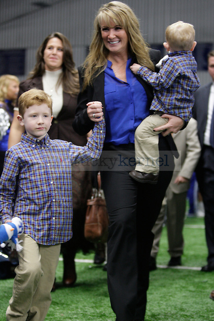 Mark Stoops' wife, Chantel, and children Zack and Will during Mark Stoops' press conference in Nutter Field House in Lexington, Ky., on Sunday, December 2, 2012. Photo by Genevieve Adams | Staff