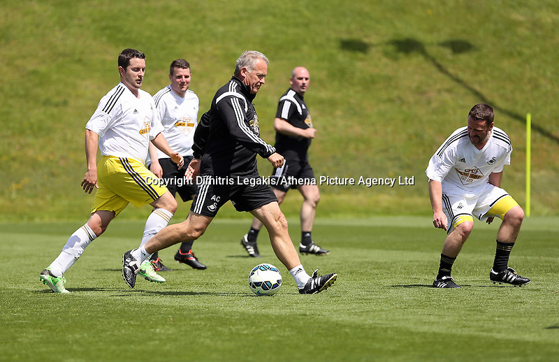 Pictured: Alan Curtsi (C) and Chris Barney (L) Thursday 21 May 2015<br /> Re: Sports reporters v Swansea City FC members of coaching staff football game at Fairwood Training ground.