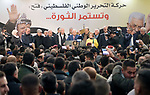 Palestinian President Mahmoud Abbas speaks during a ceremony marking the 54th anniversary of Fatah's founding, in the West Bank city of Ramallah, on December 31, 2018. Photo by Thaer Ganaim