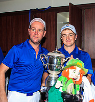 Paul Dunne and caddy Darren Reynolds with the Eurasia Cup after Team Europe overcame Asia 14/10 at Glenmarie Golf and Country Club on the Sunday 14th January 2018.<br /> Picture:  Thos Caffrey / www.golffile.ie