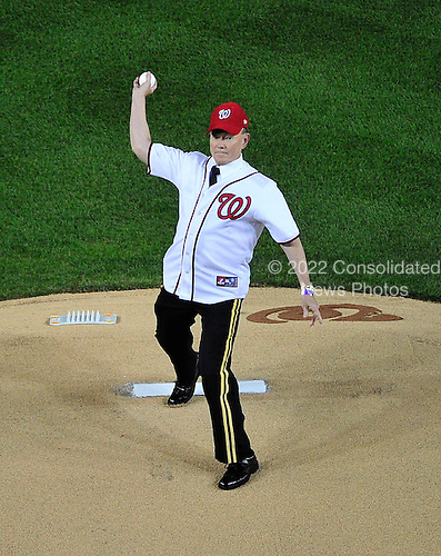 United States Army General Martin E. Dempsey, Chairman of the Joint Chiefs of Staff, throws out the ceremonial first pitch prior to game 5 of the NLDS pitting the St. Louis Cardinals against the Washington Nationals at Nationals Park in in Washington, D.C. on Friday, October 12, 2012.  The Cardinals won the game and the series 9 - 7..Credit: Ron Sachs / CNP