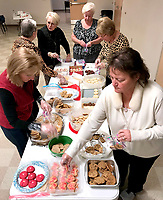 Janelle Jessen/Herald-Leader<br /> Members of the Siloam Springs and Gentry chapters of the Circle of Life Hospice Auxiliary packed the Valentines cookies they baked for hospice staff members on Tuesday at First Baptist Church in Siloam Springs. More than 200 hospice staff members, including those who work at the Bentonville and Springdale locations as well as mobile staff, will receive a package of cookies on Valentines Day, according to Kelly Horrell, Circle of Life Hospice giving manager.