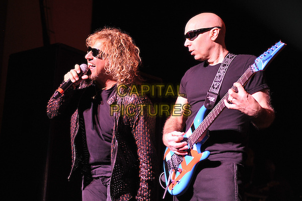 Sammy Hagar and Joe Satriani.Chickenfoot performing live in concert, Brixton Academy, London, England. 14th January 2012.on stage gig performance music half length black suit sunglasses shades guitar t-shirt .CAP/MAR.© Martin Harris/Capital Pictures.
