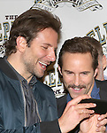 Bradley Cooper and Alessandro Nivola attend the 'The Elephant Man' Broadway Cast photo call at Sardi's on October 21, 2014 in New York City.